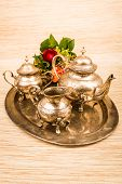 stock photo of pompous  - metal teapot in bronze for coffee and tea  - JPG