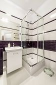stock photo of shower-cubicle  - Modern bathroom with shower cubicle in violet color - JPG