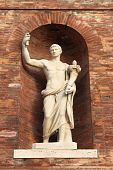 image of tyranny  - Roman emperor statue with cornucopia located in Quirinale Square - JPG