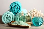 pic of sea salt  - Spa composition with towels and sea salt on light background - JPG