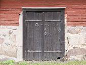 stock photo of basement  - Wooden black doors on a warehouse - JPG