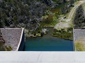picture of dam  - Tooma Dam is a major ungated concrete embankment dam across the Tooma River in the Snowy Mountains of New South Wales in Australia - JPG