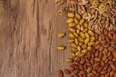 picture of mixed nut  - Mixed nuts on wooden background  - JPG