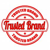 foto of trust  - label stamp with text trusted brand on vector illustration - JPG