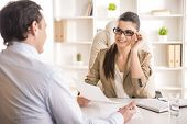 stock photo of interview  - Businesswoman interviewing male candidate for job in office - JPG