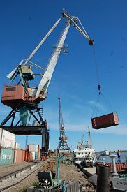 image of coal barge  - Dockside cargo crane with container at river port Kolyma Russia - JPG