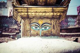 stock photo of shankar  - Buddha eyes close up with prayer flags at Bodhnath stupa in Kathmandu valley Nepal - JPG