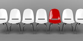 picture of uniqueness  - One unique red chair in a row of white chairs - JPG