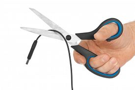 picture of wiretap  - Hand with scissors and computer cable isolated on white background - JPG