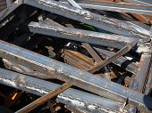 image of scrap-iron  - Pile of various sized scrap iron profiles in a scrap metal pile used for industrial transport packaging with slight rust - JPG