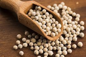 picture of peppercorns  - White peppercorn on wooden background - JPG