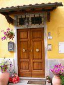picture of wooden door  - a doorway in tuscany with flowers and wooden door - JPG