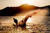 stock photo of watersports  - Silhouette of a water skier - JPG