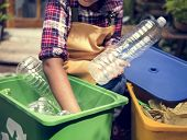 African Descent Kid Separating Recyclable Trash poster