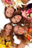 stock photo of hula dancer  - Low angle view of happy beautiful hawaiian Hula Dancer Girls standing together in a circle - JPG