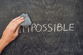 Making The Impossible Possible Concept On Blackboard Background poster