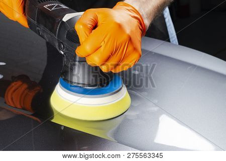poster of Car Polish Wax Worker Hands Applying Protective Tape Before Polishing. Buffing And Polishing Car. Ca