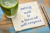 eating well is a form of self-respect - handwriting on a napkin with a glass of fresh, green, vegeta poster