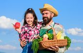 Family Farm Concept. Only Organic And Fresh Harvest. Man Bearded Rustic Farmer With Kid. Farmer Fami poster