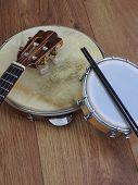 Close-up Of Three Brazilian Musical Instruments: Cavaquinho, Pandeiro (tambourine) And Tamborim With poster