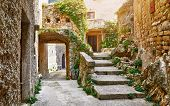 Croatia Istria. Ancient abandoned medieval town Plomin. Old stone street with ruined walls houses an poster