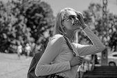 Woman Sunglasses Enjoy Walk Sunny Day, Urban Background. Urious Tourist. Trendy Girl Walking. Woman  poster