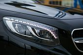 Headlight Of A Modern Luxury Car, Auto Detail, Car Care Concept poster
