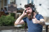Enjoy Free Songs Everyday. Man Bearded Hipster With Headphones Listening Music. Hipster Enjoy High Q poster