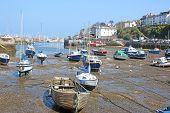 Boats In Brixham Harbour, Devon At Low Tide poster