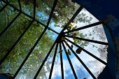 Blue Sky And Tree Branches Through An Old-style Stained Glass Window, A Semicircle Of Glass, Dirty G poster