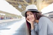 Attractive Beautiful Woman Is Waiting Train For Traveling Around The City. Charming Beautiful Young  poster