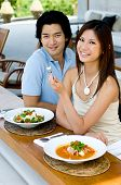 picture of thai food  - A young attractive couple eating Thai food - JPG