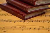 stock photo of pop up book  - Close up of Music sheet and old books - JPG