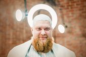 A Red Bearded Angel With A Halo Upon His Head Is Smiling. poster