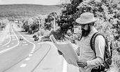 Tourist Backpacker Looks At Map Choosing Travel Destination At Road. Around The World. Find Map Larg poster