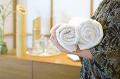 Chambermaid Holding Clean Towels In Spa. Clean White Towel In A Spa Centre. Staff Cleaning Lady Hold poster