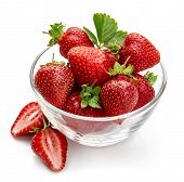 Berry strawberry with green leaf in glass dish fruit cut still life, isolated on white background. poster