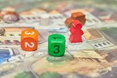 Themed Board Games. Colorful Play Figures With Dice On Board. Vertical View Of The Board Game Close- poster