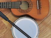 Close-up Of Two Brazilian Musical Instruments: Cavaquinho And Tamborim With Drumstick On A Wooden Su poster