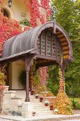 stock photo of entryway  - Entryway of building decorated with autumn flowers and plants - JPG