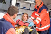 image of accident victim  - Paramedics helping woman in ambulance broken arm smiling accident victim - JPG