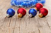pic of shaky  - Small New Year decoration balls on old wooden background - JPG