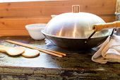 foto of chinese wok  - an old chinese wok in the kitchen - JPG