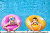 Picture of happy children having fun in the swimming pool.