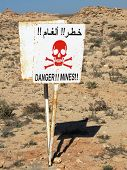 stock photo of landmines  - Danger sign near the Moroco - JPG