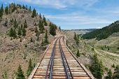 stock photo of trestle bridge  - A wooden railroad trestle in southern Colorado - JPG