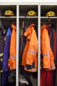 stock photo of medevac  - Fire fighter suits at the fire station.