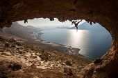 Family rock climber at sunset. Kalymnos, Greece.