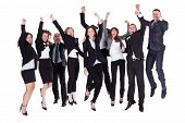 image of excite  - Group of jubilant business people jumping for joy and shouting in their excitement at their success isolated on white - JPG