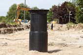 image of sewage  - A black sewage pipe connection point in a construction site - JPG